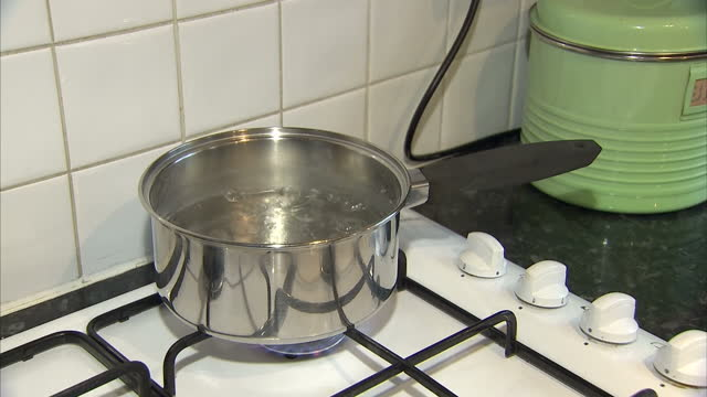 interior shots of a pan of water boiling on a gas hob. domestic energy use setups. on november 12, 2013 in ipswich, england - boiling stock videos & royalty-free footage