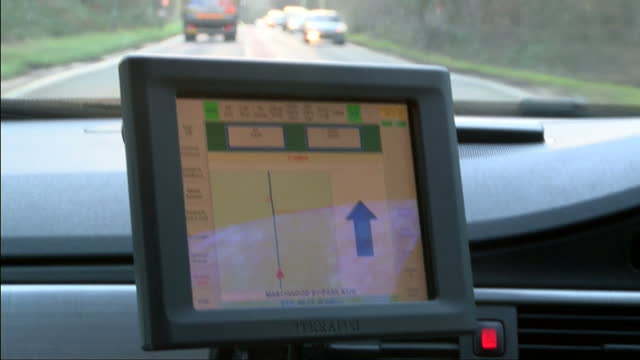 Interior shots of a paramedic driving an ambulance responding to an emergency call The ambulance sirens are in use Paramedic Driving an Ambulance...