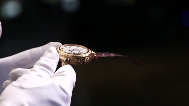 interior shots of a patek philippe watch held by white gloved hands in new york city new york on 1152014 no sound /close shots of white gloved hands... - instrument of time stock videos & royalty-free footage