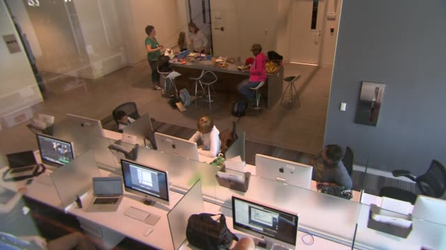 Interior shots of a post production facility where editors and graphic designers work on Apple computers at the YouTube Production Facility in...