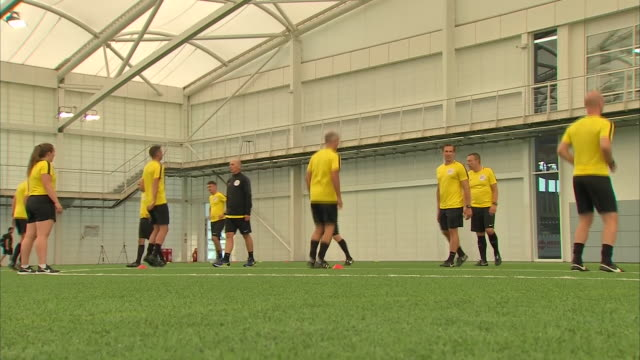 vidéos et rushes de interior shots of a premier league referees training session happening at st georges park the english football association's national football centre... - s'entraîner