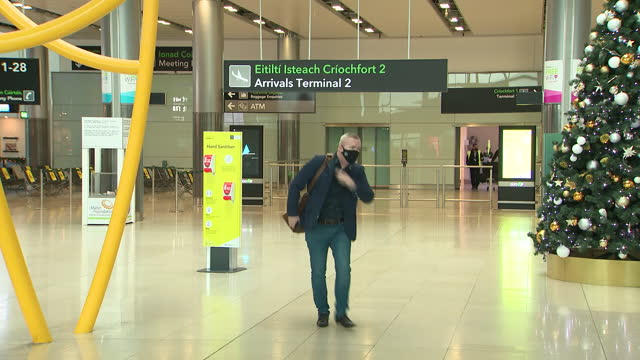 interior shots of a quiet dublin airport terminal with social distancing signage and flight arrival monitors showing arrivals from various european... - ireland stock videos & royalty-free footage