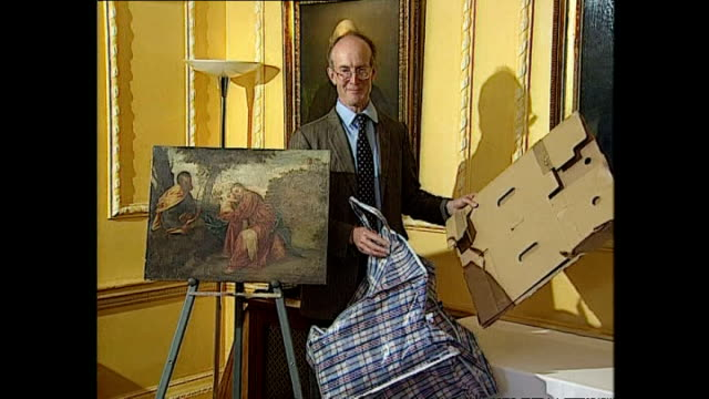 interior shots of a recovered titian painting, 'rest on flight into egypt' being shown off by tim moore, art curator and alexander hope, art expert,... - kunst, kultur und unterhaltung stock-videos und b-roll-filmmaterial