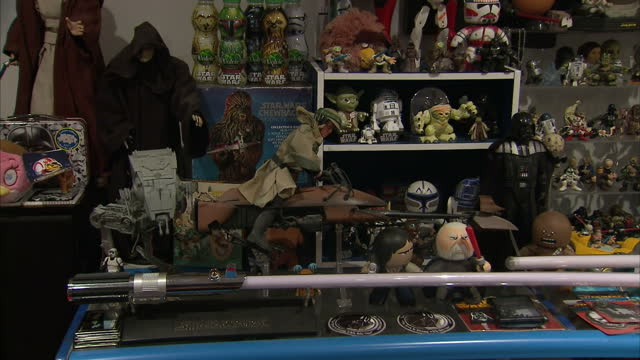 interior shots of a room filled with a large collection of star wars toys and memorabilia>> on december 20 2015 in bury st edmunds england - bury st edmunds stock videos & royalty-free footage