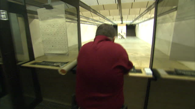 interior shots of a shooting enthusiast firing a semi automatic pistol at a paper target depicting a man on july 02, 2014 in athens, georgia. - darstellen stock-videos und b-roll-filmmaterial