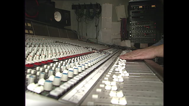 interior shots of a sound mixing console with fader switches labelled according to recording artist including jason kylie during a recording session... - pop music stock-videos und b-roll-filmmaterial