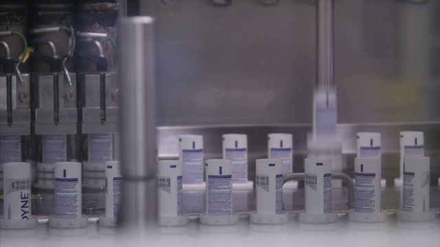 interior shots of a toothpaste production line with tubes of sensodyne toothpaste moving through factory machinery on february 03 2017 in london... - toothpaste stock videos & royalty-free footage