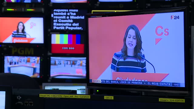 interior shots of a tv news production gallery with vision mixer director and other staff producing the live output of catalonia's 3/24 rolling news... - 記者会見点の映像素材/bロール