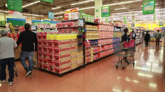 interior shots of a walmart in mexico city mexico as customers push shopping carts up and down various aisles and browsing products close up shots of... - push cart stock videos and b-roll footage