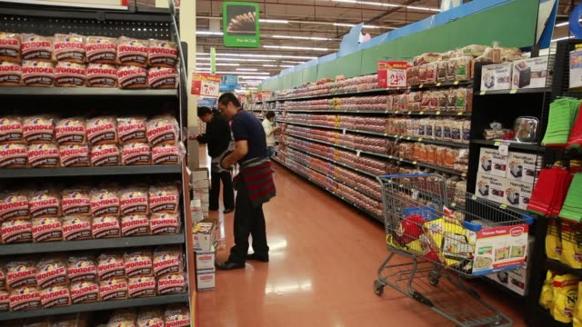 interior shots of a walmart in mexico city mexico as customers push shopping carts up and down various aisles and browsing products close up shot of... - frozen food stock videos & royalty-free footage