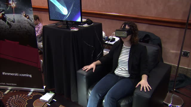 interior shots of a woman trying out an immersit 4d motion device that moves the chair and provides physical feedback while paired with a virtual... - pair stock videos and b-roll footage