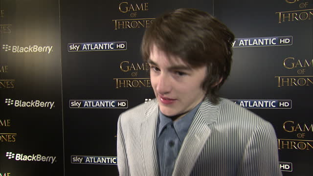 Interior shots of actor Isaac HempsteadWright giving an interview on the red carpet at the Game of Thrones premiere on March 26 2013 in London England