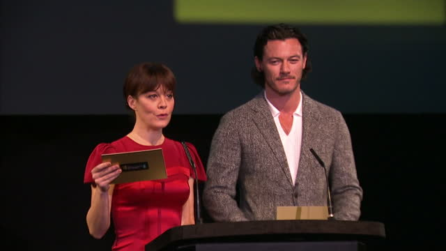 interior shots of actors luke evans and helen mccrory announcing nominations for bafta awards on stage. bafta nominees announced on january 08, 2014... - ヘレン マックローリー点の映像素材/bロール