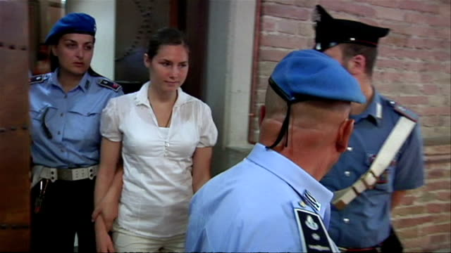 Interior shots of Amanda Knox being led into Perugia Courtroom in handcuffs on June 12 2009 in Perugia Italy