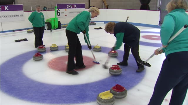 interior shots of amateur curlers playing curling at a stirling ice rink on 21st february 2014 in stirling, scotland - competition stock videos & royalty-free footage