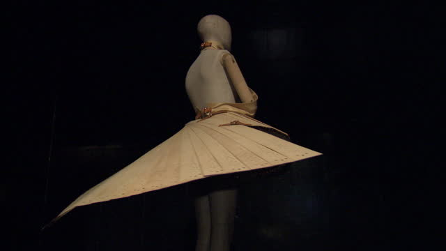 interior shots of an alexander mcqueen dress on a rotating display stand at the 'savage beauty' exhibition at the victoria and albert museum>> on... - victoria and albert museum london stock videos & royalty-free footage