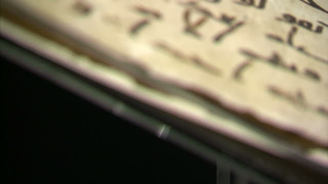 interior shots of an ancient quran manuscript radiocarbon dated as at least 1370 years old and written in the ancient arabic script of hijazi the... - arabic script stock videos and b-roll footage