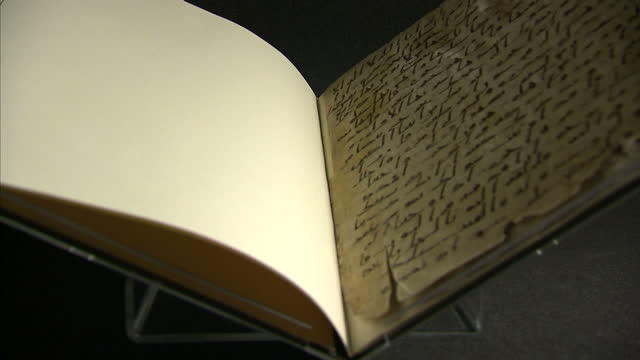 interior shots of an ancient quran manuscript radiocarbon dated as at least 1370 years old and written in the ancient arabic script of hijazi the... - arabic script stock-videos und b-roll-filmmaterial