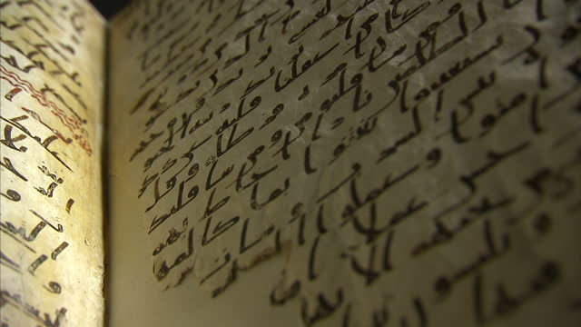 interior shots of an ancient quran manuscript radiocarbon dated as at least 1370 years old and written in the ancient arabic script of hijazi the... - manuscript stock videos and b-roll footage