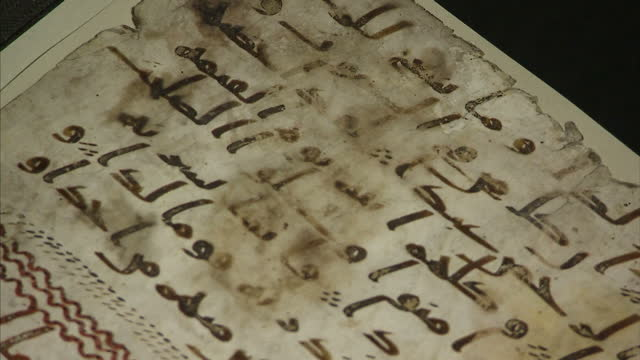 interior shots of an ancient quran manuscript radiocarbon dated as at least 1370 years old and written in the ancient arabic script of hijazi the... - non western script stock videos & royalty-free footage