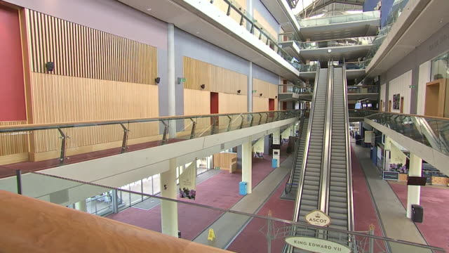 interior shots of an empty ascot foyer with cordoned off escalators - escalator stock videos & royalty-free footage