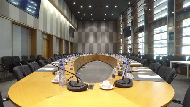 stockvideo's en b-roll-footage met interior shots of an empty conference room at the european council's europa building including shots of a place card for the united kingdom around... - ellips