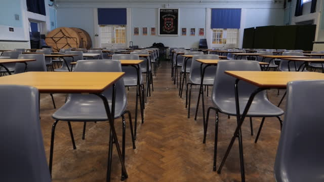interior shots of an empty exam hall with tables and chairs set up after schools were forced to close due to coronavirus restrictions on 6 january... - exam stock videos & royalty-free footage