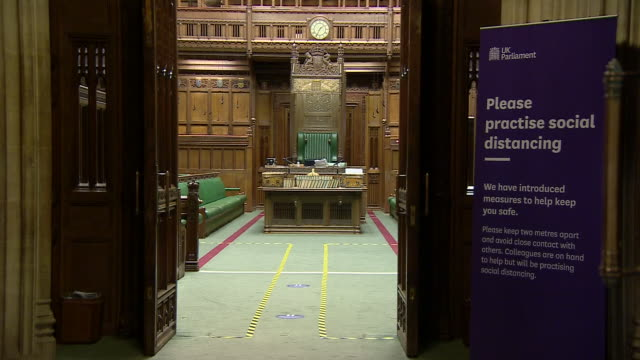 interior shots of an empty house of commons chamber with tape on the floors and signage indicating social distancing measures and red 'x' signs on... - britisches parlament stock-videos und b-roll-filmmaterial