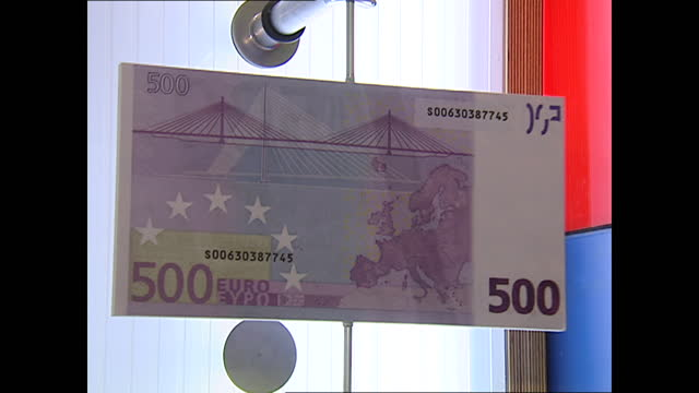 interior shots of an euro calender key dates information board and enlarged euro banknotes on display on 18th december 2001 at the eurotunnel,... - distorted stock videos & royalty-free footage