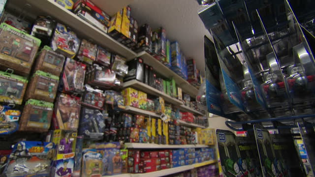 interior shots of an independent toy shop with staff working various toys and models on shelves and signs advertising cut price sales on 28 april... - stafford england stock videos and b-roll footage
