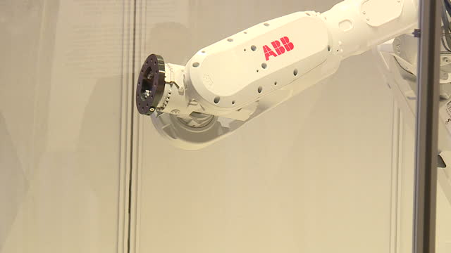 interior shots of an industrial robot named mimus in the london design museum moving its robotic arm around, in response to human movements and... - human arm stock videos & royalty-free footage