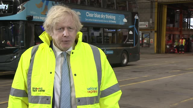 interior shots of an interview with pm boris johnson whilst visiting coventry bus depot, speaking about the police action against women protesters... - talking stock videos & royalty-free footage