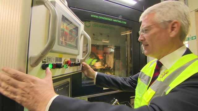 interior shots of andrew jones mp exchequer secretary to the treasury at the controls of a machine in the royal mint pressing buttons to allow the... - royal mint stock videos & royalty-free footage