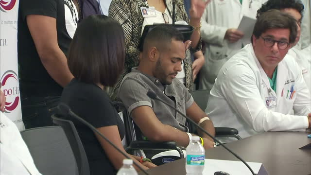 Interior shots of Angel Colon Orlando nightclub shootings survivor and medical staff speaking at press conference on June 14 2016 in Orlando Florida