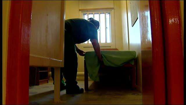 interior shots of anonymous female inmate making bed in prison cell on october 24 2013 in england - prisoner rehabilitation stock videos & royalty-free footage