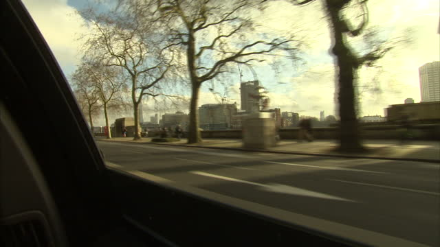 interior shots of anonymous hand starting car reading road map of london driving around the streets of london with views of cars and river thames... - road map stock videos & royalty-free footage