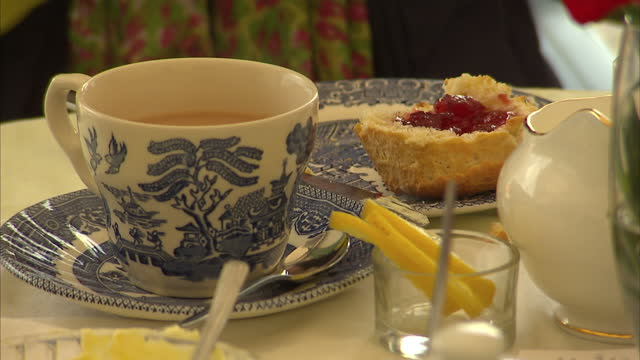 interior shots of anonymous people enjoying afternoon tea in a traditional cafe drinking tea and eating scones with jam and cream on march 16 2015 in... - afternoon tea stock videos & royalty-free footage