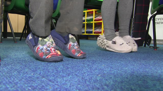 interior shots of anonymous primary school children wearing slippers in the classroom on january 31, 2017 in derby, england. - slipper stock videos & royalty-free footage