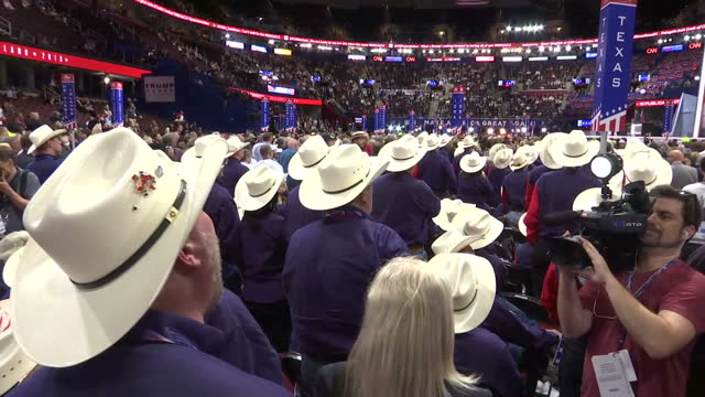 Interior shots of anti Donald Trump protesters shouting 'Roll Call Vote' inside the Republican National Convention venue all of them wearing white...