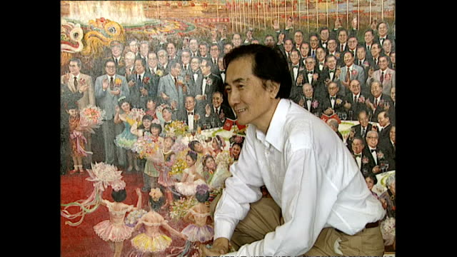 """vidéos et rushes de interior shots of artist liu yuyi posing in front of his painting """"festive day"""" which depicts hong kong and chinese ministers celebrating the... - troc"""
