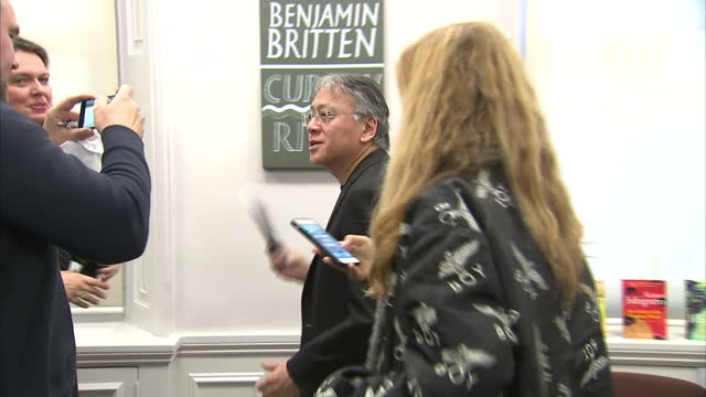 interior shots of author kazuo ishiguro departing after giving a news conference, having been announced as the winner of the 2017 nobel prize for... - nobel prize in literature stock videos & royalty-free footage