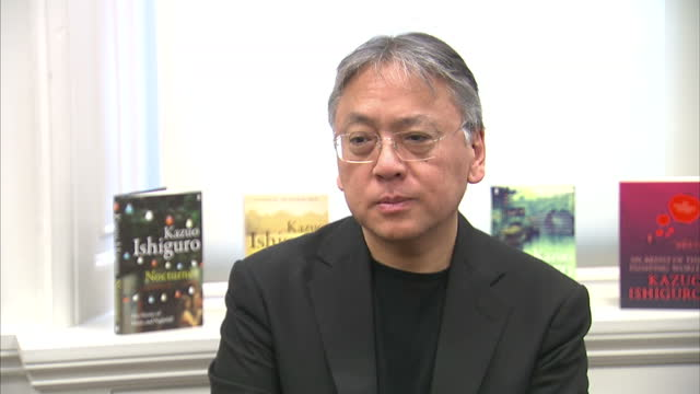interior shots of author kazuo ishiguro speaking during a news conference after being announced as the winner of the 2017 nobel prize for literature... - kazuo ishiguro stock videos & royalty-free footage