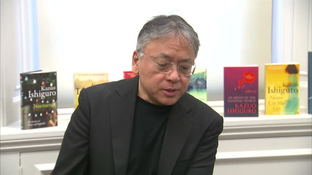 interior shots of author kazuo ishiguro speaking during a news conference after being announced as the winner of the 2017 nobel prize for literature.... - nobel prize in literature stock videos & royalty-free footage