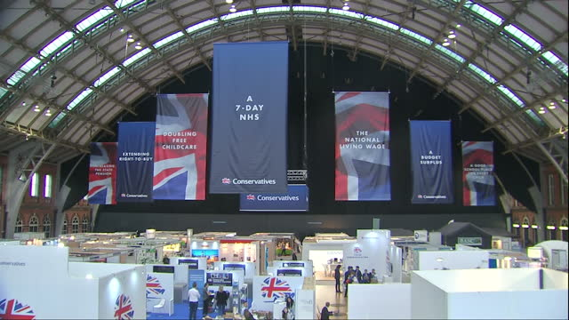 Interior shots of banners listing Conservative manifesto pledges hanging in an exhibition hall at Manchester Central convention centre during the...
