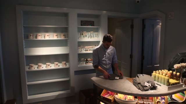 interior shots of barons cove hotel and restaurant in sag harbor ny monday may 11 2015 shots an employee stocks shelves in the gift shop an employee... - sweatshirt stock videos & royalty-free footage