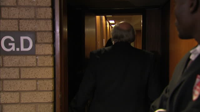 interior shots of barry steenkamp father of reeva steenkamp arriving at court to hear the summing up in the trial of oscar pistorius>> on august 08... - オスカー・ピストリウス点の映像素材/bロール