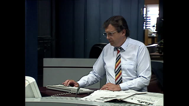 interior shots of bbc journalists working at computers and speaking on phones in the newsroom at television centre on may 20 1992 in london england - bbc archive stock-videos und b-roll-filmmaterial