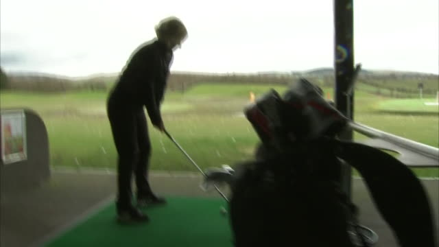 interior shots of becky morgan practicing on driving range on the 14th march in glasgow, scotland - drive ball sports stock videos & royalty-free footage