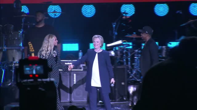 interior shots of beyonce and hillary clinton hugging on stage and jay z with his arm around hillary clinton on november 4 2016 in cleveland ohio... - beyoncé knowles stock videos & royalty-free footage