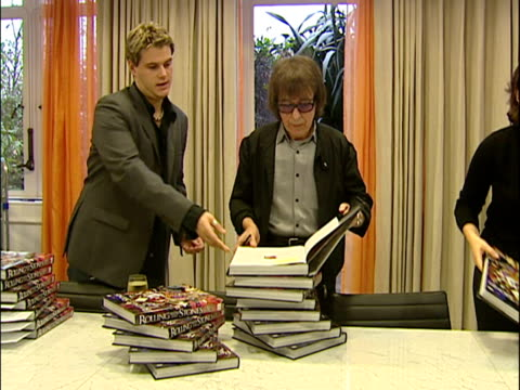 vidéos et rushes de interior shots of bill wyman signing copies of his autobiography book rolling with the stones sky news archival content of rolling stones at various... - book